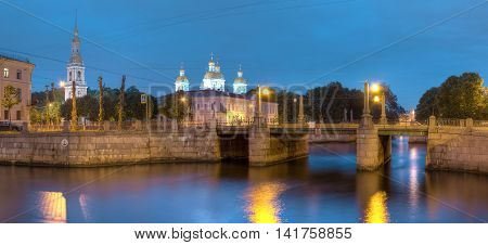 Night view on illuminated Griboedov Canal Pikalov Bridge and St. Nicholas Naval Cathedral St. Petersburg Russia