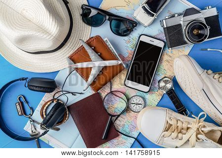 Overhead view of Traveler's accessories Essential vacation items Travel concept background