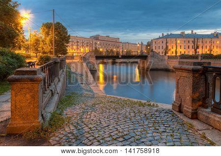Night view on illuminated embankment of Griboedov Canal and Krasnogvardeysky Bridge St Petersburg Russia