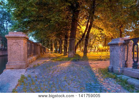 Night view on illuminated alley on the embankment of Griboedov Canal St. Petersburg Russia