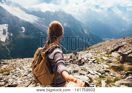 Pre teen girl walking on the top of the mountain, autumn hike with backpacks, alpine view