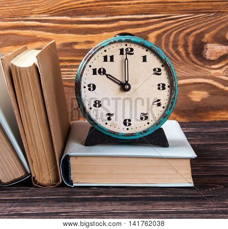 Old Books And Clock