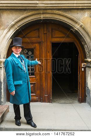 Lviv Ukraine - april 14 2015: An actor in makeup doorkeeper posing in the old town near the town hall Lviv Ukraine
