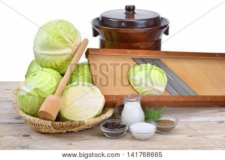 Food fermentation, preparation for making sauerkraut: German white cabbage, caraway seeds, juniper berries, salt, whey, dill, a shredder, a tamper and a crock pot