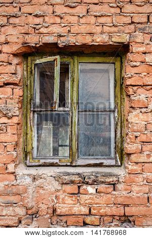Old red brick wall with small window abstract architecture background