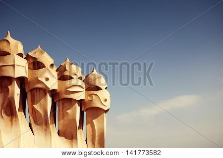 BARCELONA - DEC 1: Gaudi Chimneys at Casa Mila also called La Pedrera on Dec 1, 2016 in Barcelona. Terrace of the Casa Mila, with chimneys shaped anthropomorphic soldiers, created by Gaudi. Spain