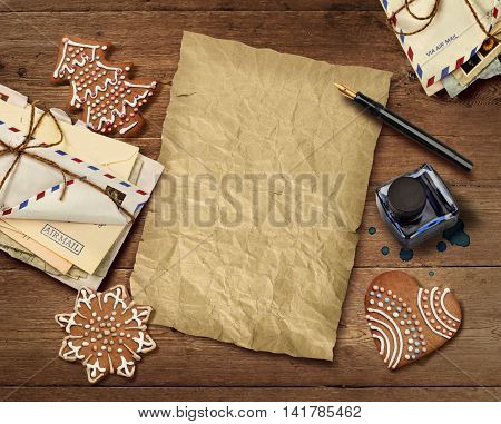 Christmas wish list letter to Santa on old wooden table background