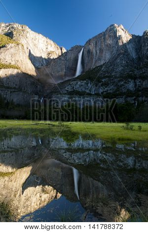 Yosemite water falls with a flooded valley reflection
