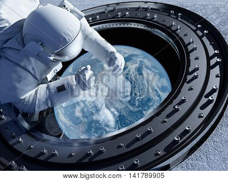 Astronaut is looking at Earth through the porthole.