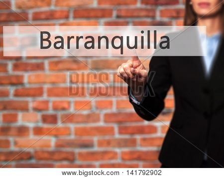 Barranquilla - Female Touching Virtual Button.