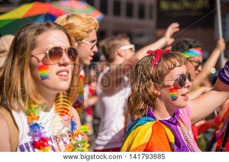 Toronto CA - 3 July 2016: Happy parade goers participate in 2016 Toronto Gay Pride March