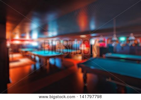 abstract blur. brand new and modern billiard interior in night time.