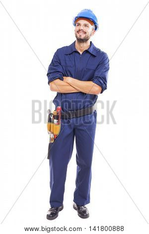 Young worker with arms crossed on white background
