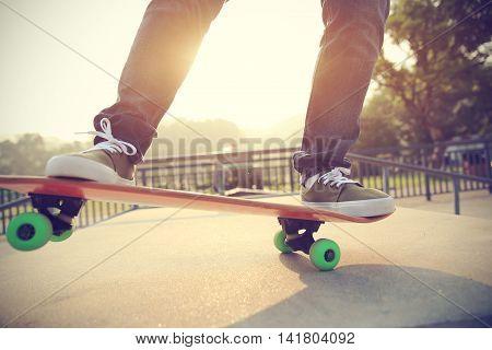 one skateboarder legs skateboarding at skate park