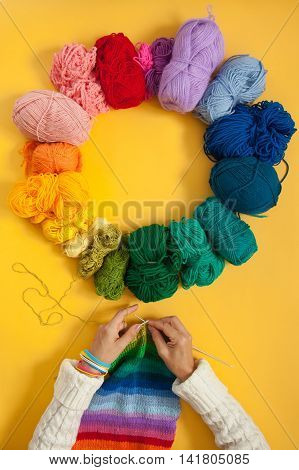 Balls Of Colored Yarn. Sample Knit. Women's Hands Are Knitted.