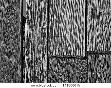 Grooves and patterns of the hardwood bridge across the canal