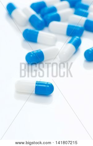 Close up medical capsule on the white background