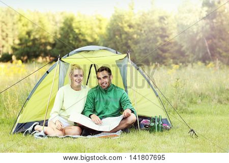 Picture showing couple camping in forest