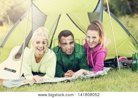 Picture showing group of friends camping in forest