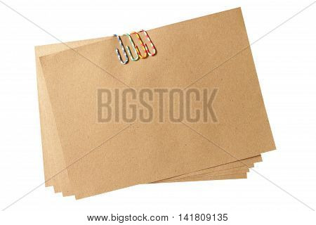 colorful paper clip with brown paper note