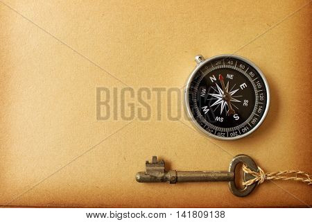 old brown paper with compass and key