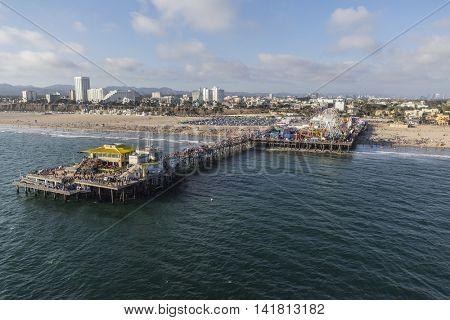 Santa Monica, California, USA - August 6, 2016:  Aerial of summer crowds on popular Santa Monica Pier near Los Angeles.