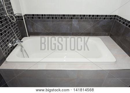 Bathtub white ceramic interior in the bathroom