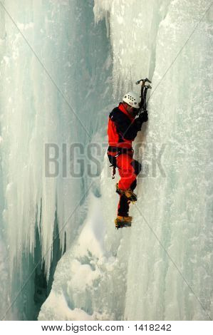 Male In Orange One Piece Suit Ice Climbing