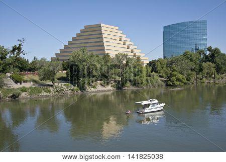 Ziggurat building glass tower building and Sacramento river California.