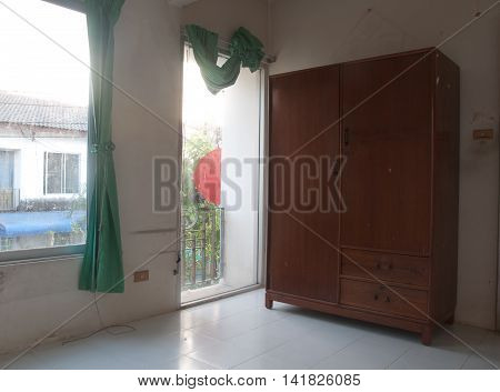 Old wood wardrobe in empty room, my house