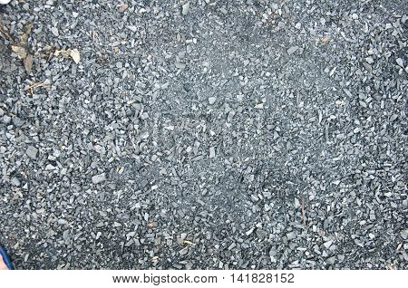 Crushed gravel texture on ground, stone background