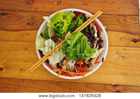 healthy vegetables salad on wood table, top view