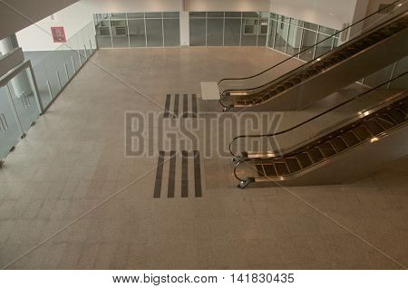 Big escalator in an airport, empty no body
