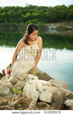 Girl Look Into Water Of Lake