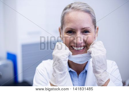 Portrait of female dentist smiling in dental clinic