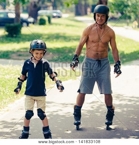 Grandfather and grandson having fun, square image