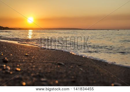 The sun comes from the Italian sea coast