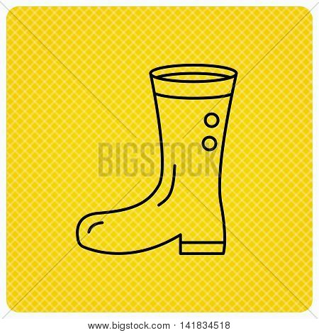Boots icon. Garden rubber shoes sign. Waterproof wear symbol. Linear icon on orange background. Vector
