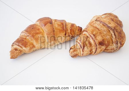Breakfast with fresh croissant on white background