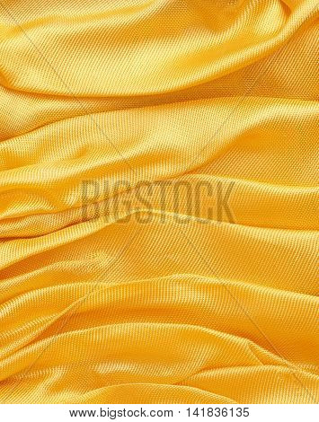 Golden fabric background with space for text or image