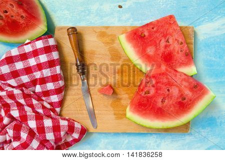 Watermelon slices on cutting board top view selective focus