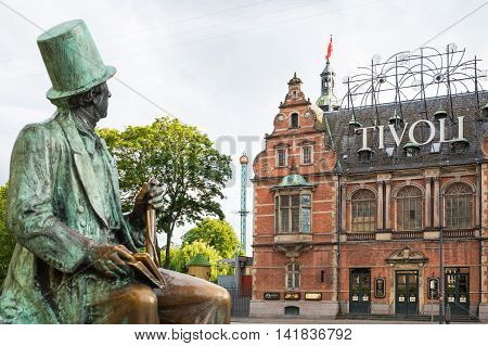 Copenhagen Denmark - July 20 2015: City Hall square the Hans Christian Andersen statue looking toward the Tivoli park entrance