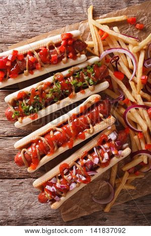 Hot Dogs With Ketchup, Mustard, Onions And French Fries. Vertical Top View