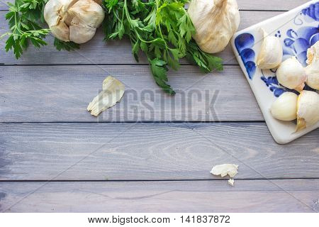 Garlic and parsley on ceramics cutting board