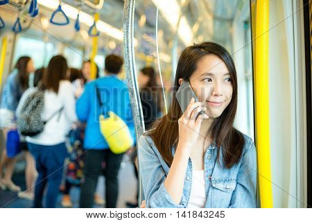 Woman talk to cellphone in train