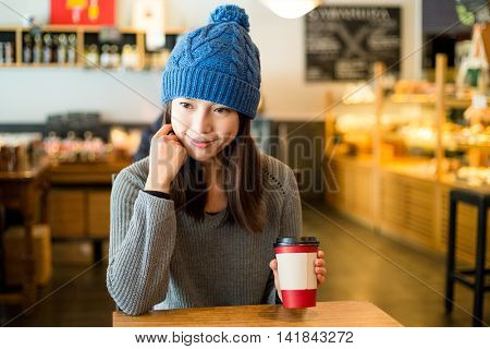 Woman enjoy her morning coffee at cafe