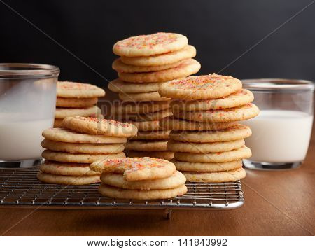 Chewy sugar cookies with glasses of milk on the table