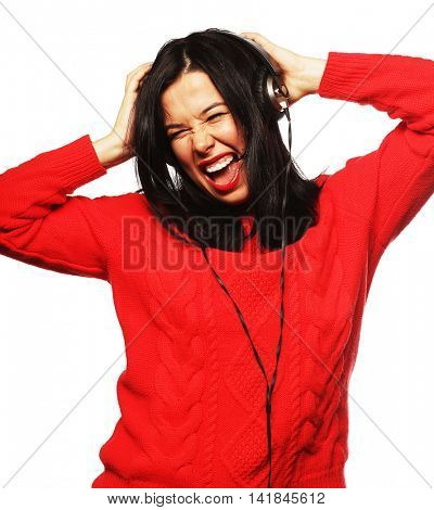 Young bright brunette woman with headphones listening music