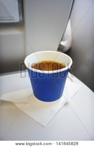 An image of a cup of tee at the plane