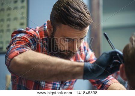 Working hairdresser in barber shop